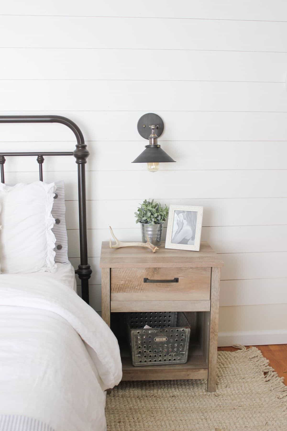 A Chic Bedside Table and Sconce