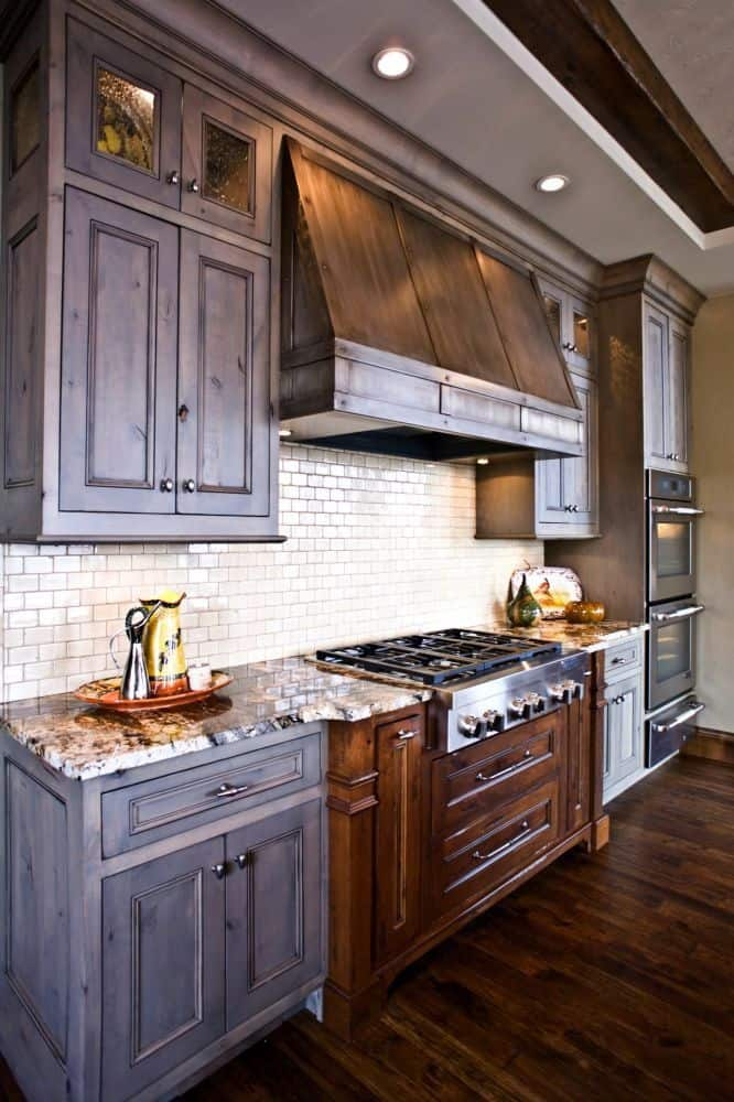 Dark Cabinets with Subway Tiles (by. dakotakitchen.com)