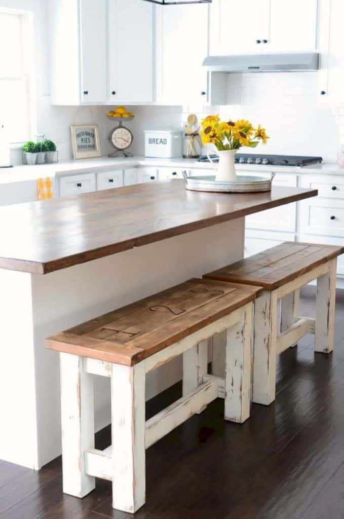 Cozy White Kitchen with Island and Bench (by. thesavvycouple.com)