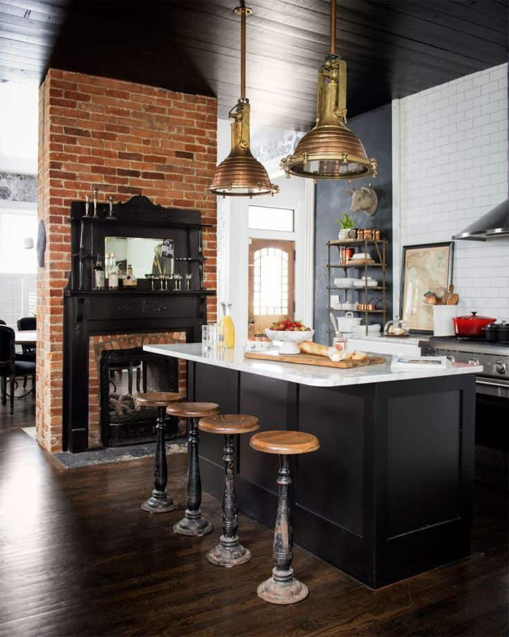 Farmhouse Kitchen with Bricks and Fireplace (by. domino.com)
