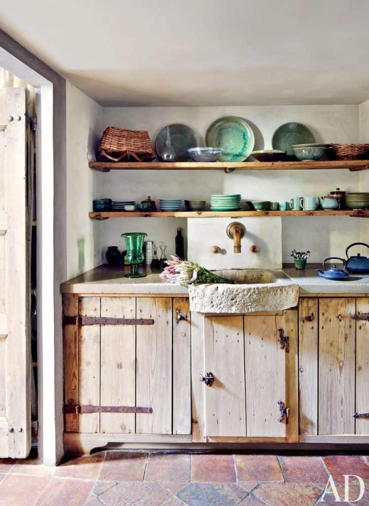 Rustic Cabinets with Long, Open Shelves (by. architecturaldigest.com)