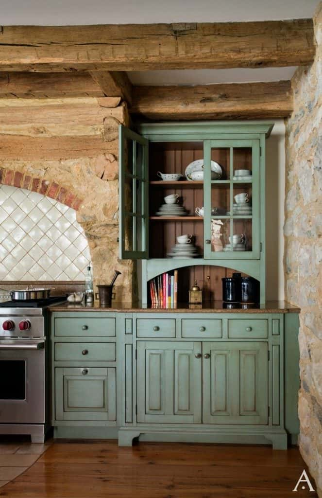 Country Kitchen Cabinets with Exposed Stone Walls (by. periodarchitectureltd.com)