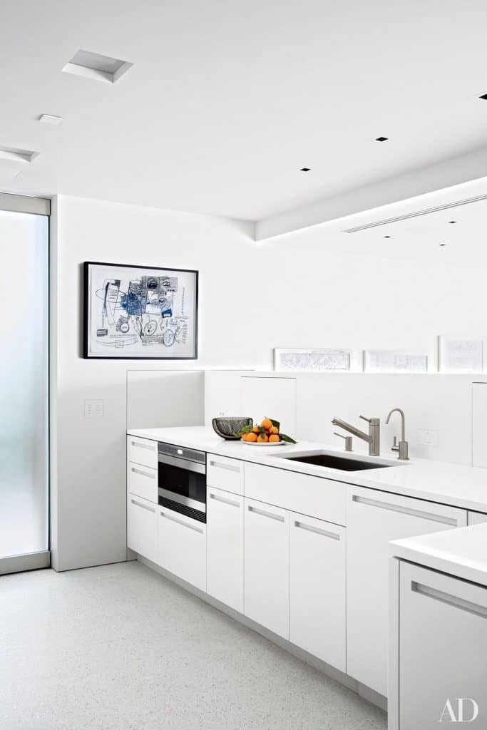 White Kitchen in Sleek Modern Design (by. architecturaldigest.com)