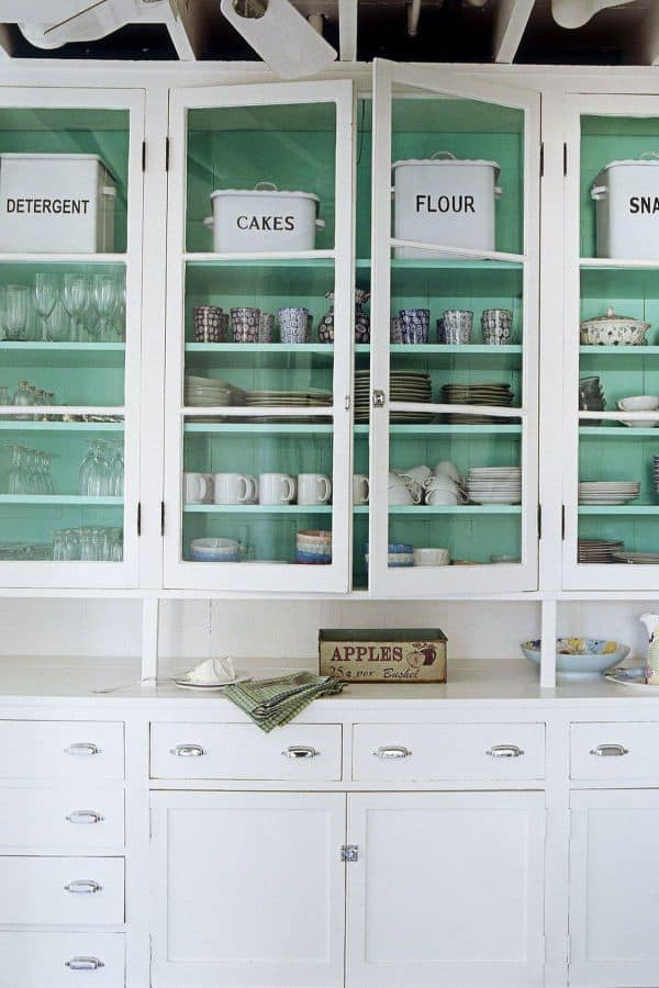 Pop of Color inside White Cabinets (by. housebeautiful.com)