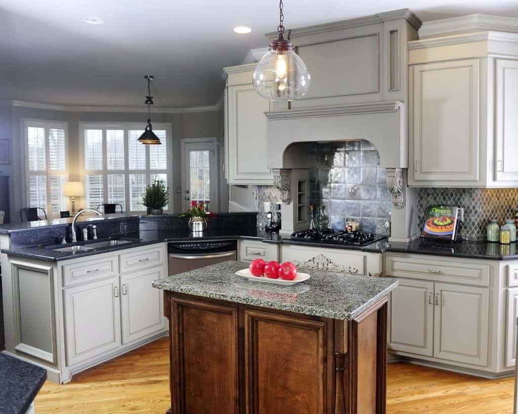 Gray Cabinets with Noticeable Stove Hood (by. bella-tucker.com)