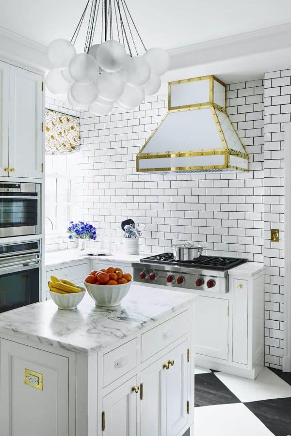 White Cabinet with Exposed Brick Wall (by. housebeautiful.com)