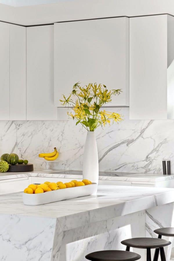 Clean-Cut Cabinet in All-White Kitchen (by. dwell.com)