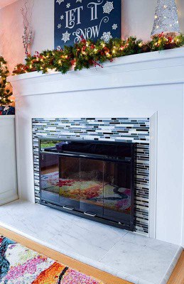 Mirrored Marble Tiles with White Fireplace Surround
