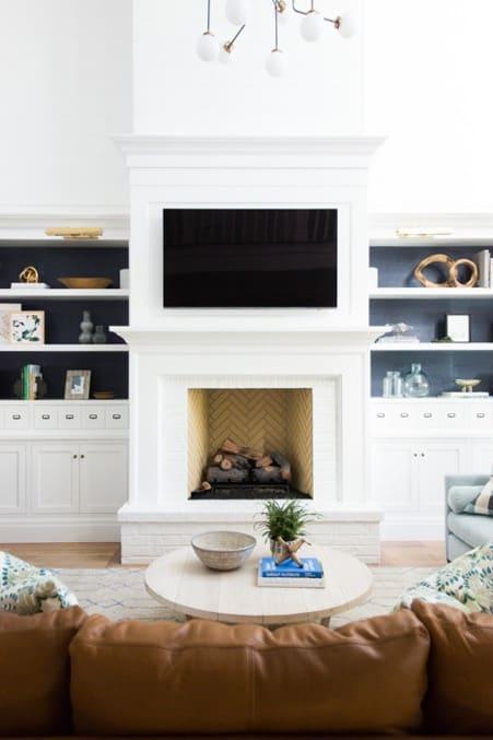Yellow Herringbone Tiles with White Fireplace